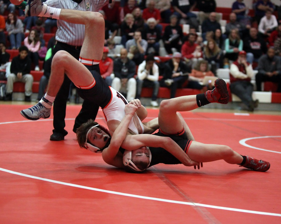 . Randy Meyers - The Morning Journal<br> Elyria\'s Colin Noel takes down Case George of Ashland during the 106-pound match at the Division I Team Dual Tournament regional quartefinals on Jan. 24.