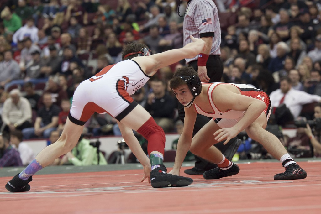 . Jen Forbus - The Morning Journal<br> Dylan Shawver of Elyria faces off against Lucas Byrd of Cincinnati LaSalle in the Division I final of the 113-pound weight division at the state wrestling tournament.