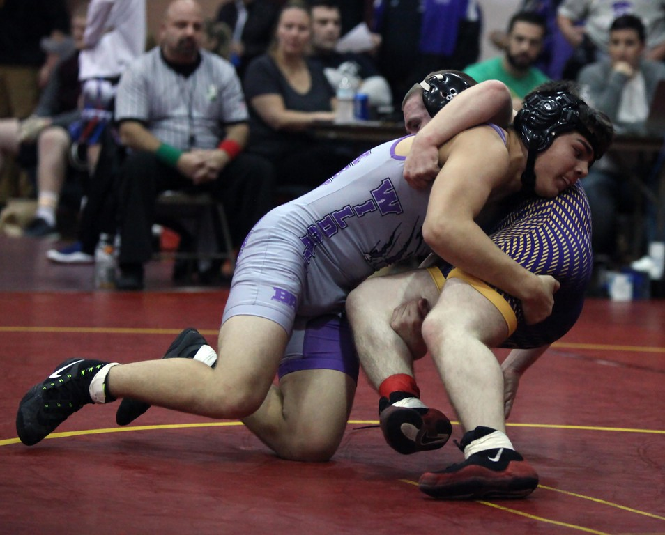 . Randy Meyers - The Morning Journal<br> Keystone\'s Hudson Hall takes down Jason Thompson of Avon during a 160-pound  match at the Avon Lake Knights of Columbus Invitational on Dec. 1.