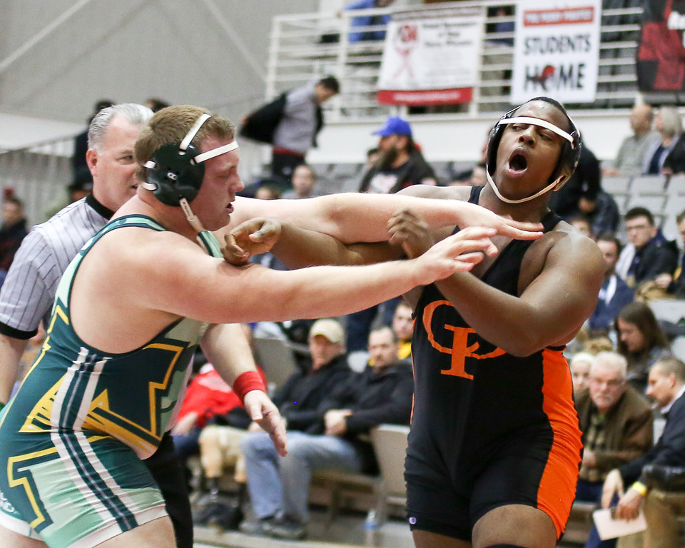. Coleen Moskowitz - The Morning Journal<br> Amherst\'s Matt Lee and Cathedral Prep\'s Kawaun Deboe face off during the 285-pound championship bout at the Perry Pin City Invitational on Jan. 6.