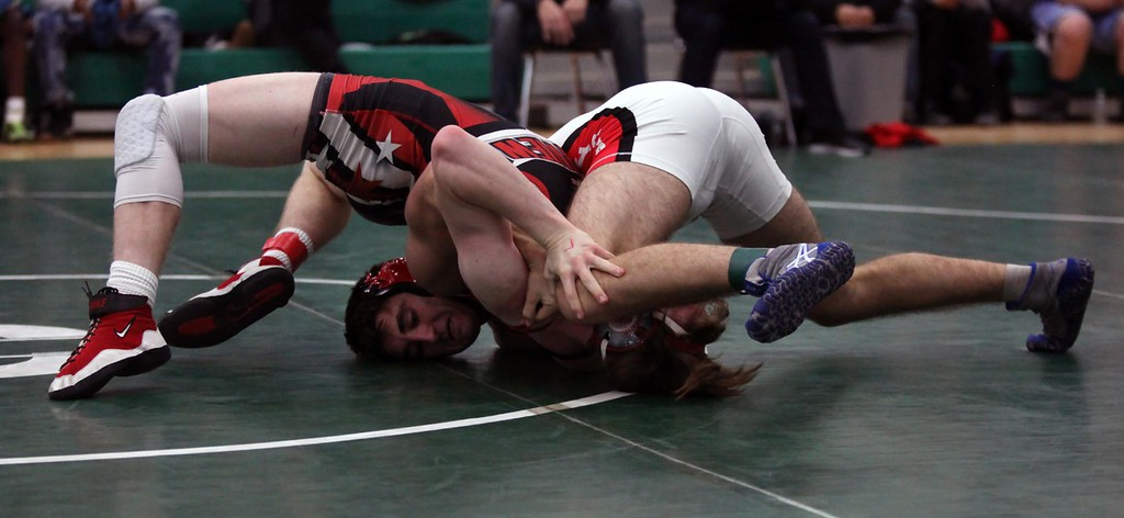 . Randy Meyers - The Morning Journal<br> Elyria\'s Jake Evans pins Declan Jewitt of Fairview during the 160-pound championship match at the Columbia Invitational on Jan. 6.