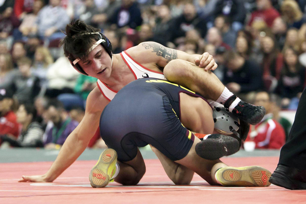 . Jen Forbus - The Morning Journal<br> Brendon Fenton of Elyria and Julian Tagg of Brecksville-Broadview Heights vie for the state title in the Division I 120-pound weight class.