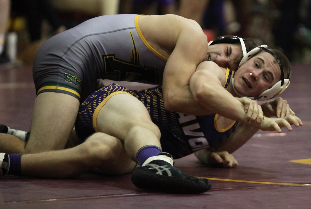 . Randy Meyers - The Morning Journal<br> Matt Stevens of Amherst takes down Luke Masisak of Avon during a 152- pound weight class match at the Avon Lake Knights of Columbus Invitational on Dec. 1.