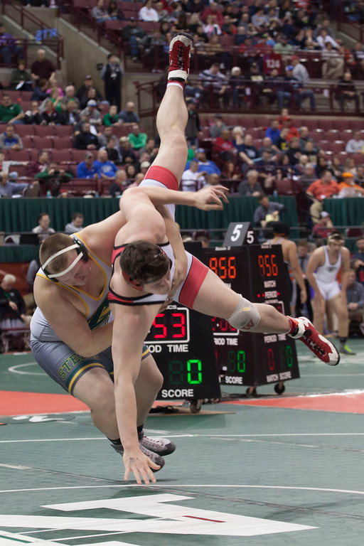 . Jen Forbus - The Morning Journal<br> Amherst\'s Matt Lee brings down Wadsworth\'s Jordan Earnest during a Division I 285-pound semifinal match at the state tournament on March 9.