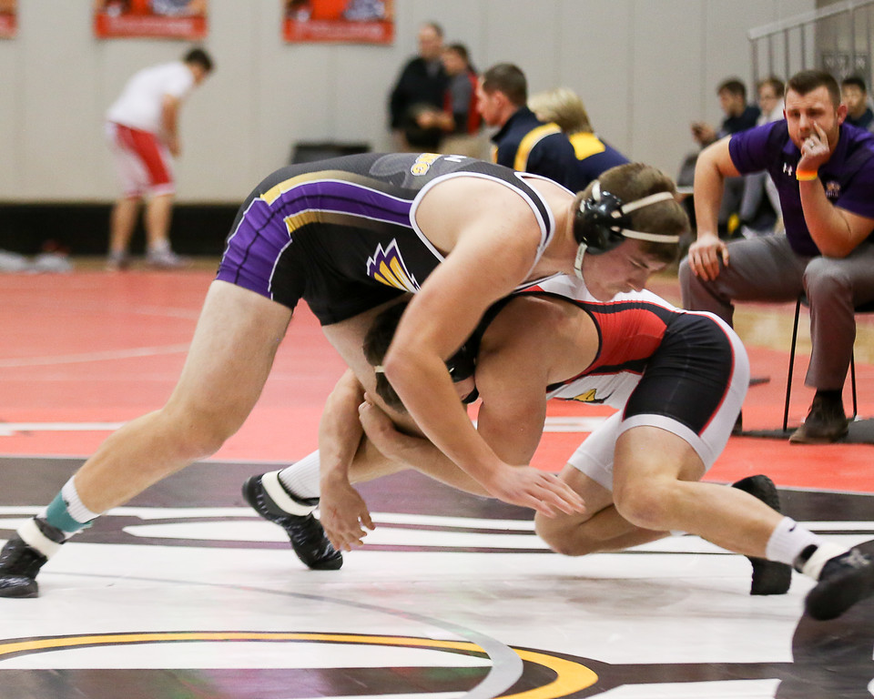 . Coleen Moskowitz - The Morning Journal<br> Coleen Moskowitz - The Morning Journal<br> Avon\'s Jack Roesch works to take down Canfield\'s Tyler Stein during the 220-pound championship bout at the Perry Pin City Invitational on Jan. 6.