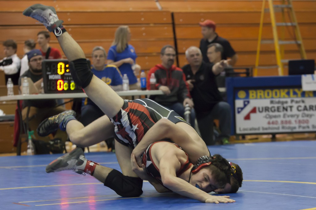 . Jen Forbus - The Morning Journal<br> Jack Jewitt of Firelands vies with Hunter Yeaples of Black River for third place in the 132-pound weight class at the Patriot Athletic Conference Championships on Feb. 10 at Brooklyn.