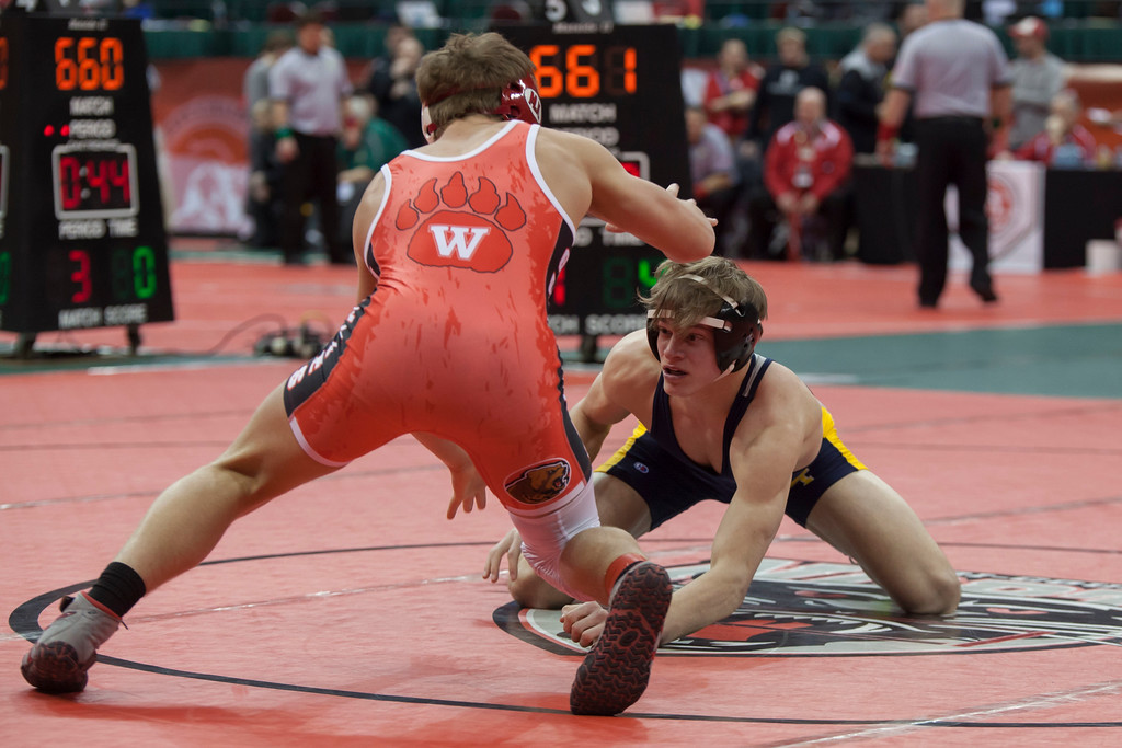 . Jen Forbus - The Morning Journal<br> Josh Jaeckin of Olmsted Falls looks for an opportunity to strike against his opponent, Michael North of Wadsworth, in a Division I 145-pound bout of the state tournament on March 9.