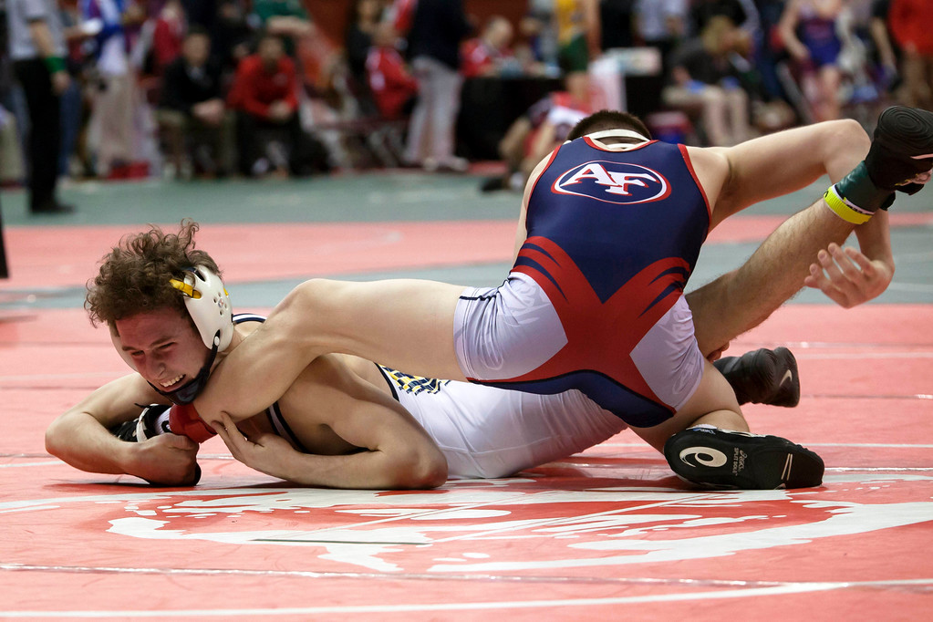 . Jen Forbus - The Morning Journal<br> Michael Shaw of Olmsted Falls vies with Colin Roberts of Austintown-Fitch in a Division I 106-pound match at the state tournament on March 9.