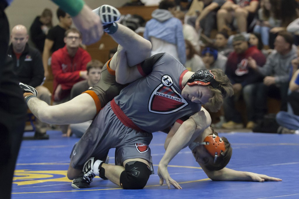 . Jen Forbus - The Morning Journal<br> Brookside\'s Chas Jackson works to take down Mike Clark of Buckeye in the championship bout of the 138-pound weight class at the Patriot Athletic Conference Championships on Feb. 10 at Brooklyn.
