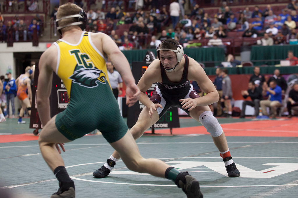 . Jen Forbus - The Morning Journal<br> In a Division III 138-pound weight class consolation round match of the state tournament, Mason Wright of Wellington vies with Jared Ford of Troy Christian.
