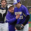 Jon Behm - The Morning Journal<br /> Vermilion coach Jeff Keck congratulates pitcher Evan Ozmun after getting out of a jam during the bottom of the first inning against Elyria Catholic on March 28 at Oberlin College.