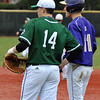 Jon Behm - The Morning Journal<br /> Vermilion's Sterling Benko, right, and Elyria Catholic's Jack Laird talk during a time out in top of the second inning on March 28 at Oberlin College.