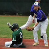Jon Behm - The Morning Journal<br /> Elyria Catholic's Gavan Hrobat (2) slides into second ahead of the tag by Vermilion's Tristan Mayer during the bottom of the third inning on March 28 at Oberlin College.