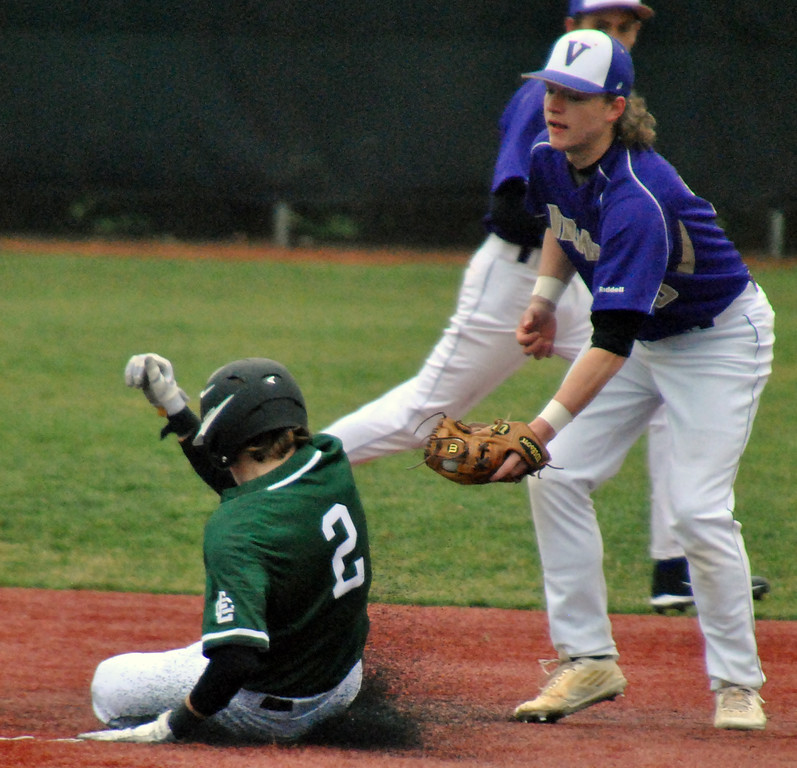 . Jon Behm - The Morning Journal Elyria Catholic\'s Gavan Hrobat (2) slides into second ahead of the tag by Vermilion\'s Tristan Mayer during the bottom of the third inning on March 28 at Oberlin College.