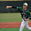 Jon Behm - The Morning Journal<br /> Elyria Catholic's Andrew Abrahamowicz delivers a pitch during the top of the first inning against Vermilion on March 28 at Oberlin College.