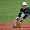 Jon Behm - The Morning Journal<br /> Elyria Catholic's Ryan Strittmather gets in front of a grounder during the top of the third inning against Vermilion on March 28 at Oberlin College.