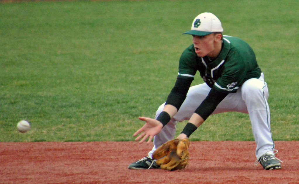 . Jon Behm - The Morning Journal Elyria Catholic\'s Ryan Strittmather gets in front of a grounder during the top of the third inning against Vermilion on March 28 at Oberlin College.