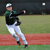Jon Behm - The Morning Journal<br /> Elyria Catholic's Tony LoParo throws to first during the top of the second inning against Vermilion on March 28 at Oberlin College.