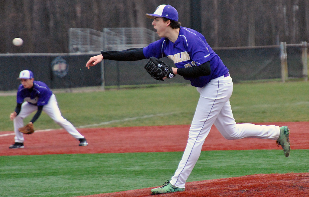 . Jon Behm - The Morning Journal Vermilion\'s Evan Ozmun delivers a pitch during the bottom of the first inning against Elyria Catholic on March 28 at Oberlin College.