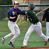 Jon Behm - The Morning Journal<br /> Elyria Catholic's Daniel Peacock (3) tries to dodge the tag of Vermilion's Mason Montgomery during the bottom of the third inning on March 28 at Oberlin College.