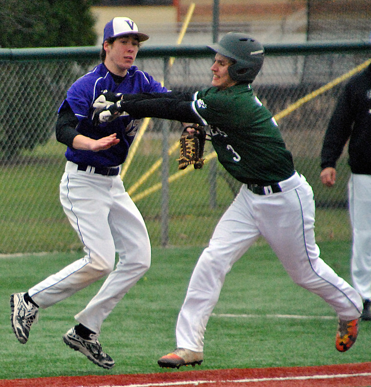 . Jon Behm - The Morning Journal Elyria Catholic\'s Daniel Peacock (3) tries to dodge the tag of Vermilion\'s Mason Montgomery during the bottom of the third inning on March 28 at Oberlin College.
