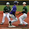 Jon Behm - The Morning Journal<br /> Vermilion's Sterling Benko beats out a flip from Elyria Catholic's Jack Laird, left, to Ryan Strittmather during the top of the second inning on March 28 at Oberlin College.