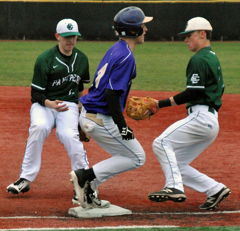 . Jon Behm - The Morning Journal Vermilion\'s Sterling Benko beats out a flip from Elyria Catholic\'s Jack Laird, left, to Ryan Strittmather during the top of the second inning on March 28 at Oberlin College.