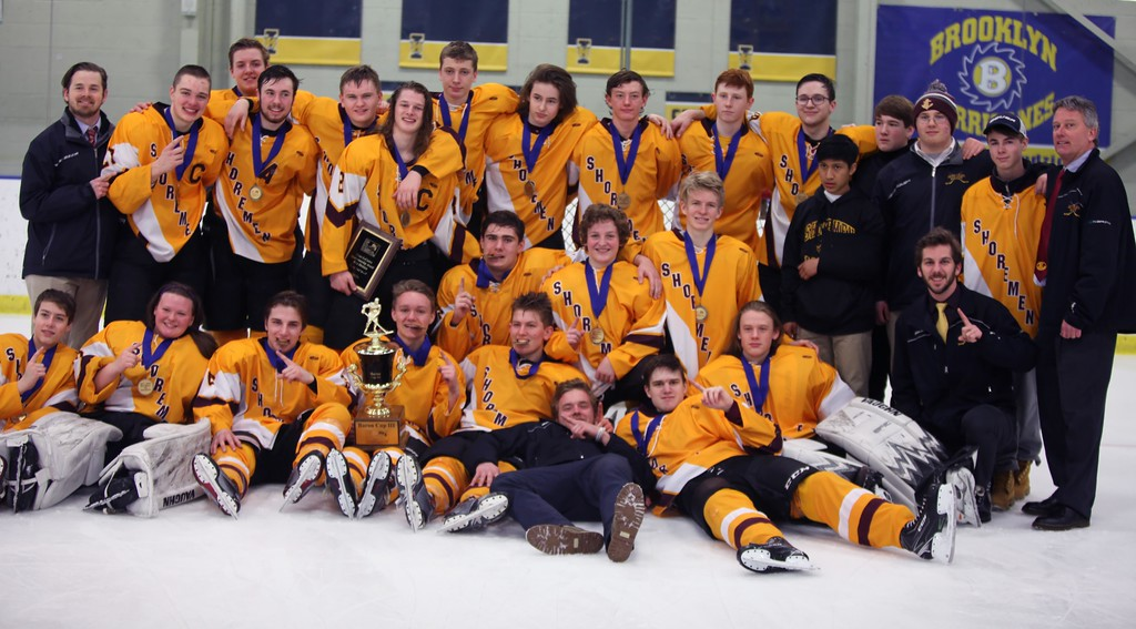 . Randy Meyers - The Morning Journal<br> Avon Lake poses with the Baron Cup III trophy following its 8-1 victory over Normandy on Feb. 11.