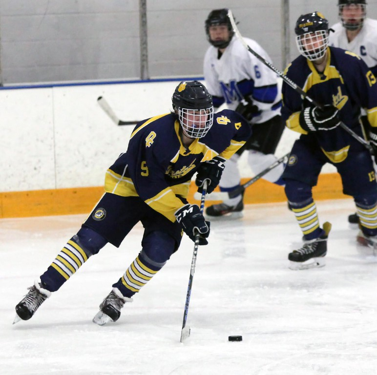. Randy Meyers - The Morning Journal<br> Dominic Conte of Olmsted Falls moves the puck away from his goal against Midview during a Southwestern Conference tournament semifinal on Jan. 15.