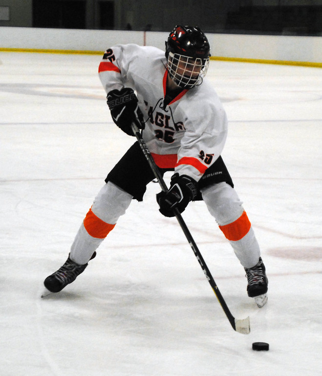 . Jon Behm - The Morning Journal<br> North Olmsted freshman Justin Christ brings the puck up ice against Kenston in a Baron Cup I quartefinal on Feb. 7 at Brooklyn\'s John M. Coyne Recreation Center.