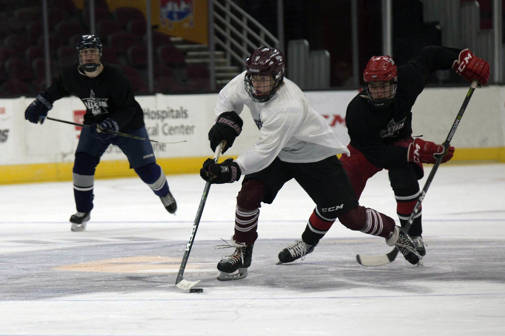 . Jen Forbus - The Morning Journal<br> Rocky River\'s Eddie Zuercher races toward the White Team\'s goal with possession of the puck.