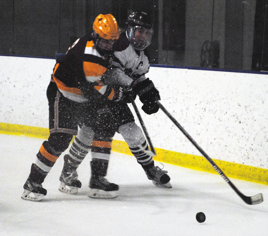 . Jon Behm - The Morning Journal<br> Rocky River\'s Ted Stueber holds off Avon Lake\'s Connor Koncelik during the first period of a Brooklyn District sectional final on Feb. 20 at Brooklyn\'s John M. Coyne Recreaction Center.