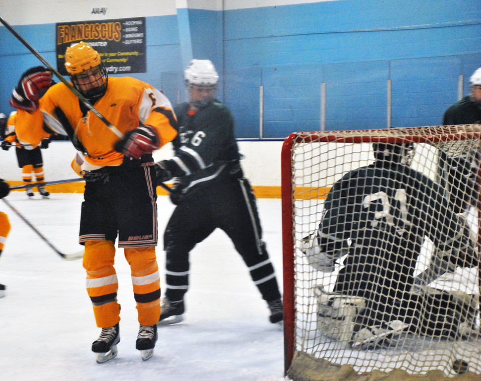 . Jon Behm - The Morning Journal<br> Avon Lake senior Connor Koncelik watches his shot get past Westlake goalie Max Novak in the first period of a Southwestern Conference Tournament first round game on Jan. 13.