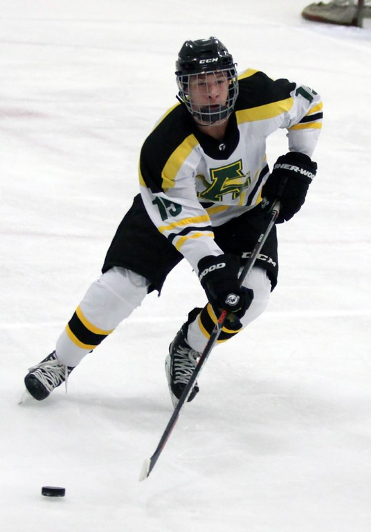 . Randy Meyers - The Morning Journal<br> Alex Dodrill of Amherst controls the puck against North Olmsted during a Southwestern Conference tournament semifinal on Jan. 15.