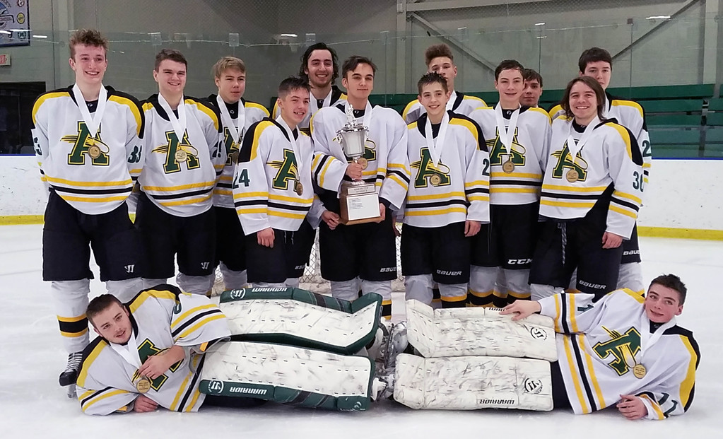 . Jon Behm - The Morning Journal<br> Amherst poses with the Baron Cup II trophy following its 5-4 win over Olmsted Falls in the Baron Cup II final on Feb. 11.
