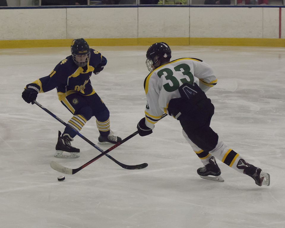 . Jen Forbus - The Morning Journal<br> Amherst\'s Tyler Waldecki faces off against Olmsted Falls\' Ethan Ilko.
