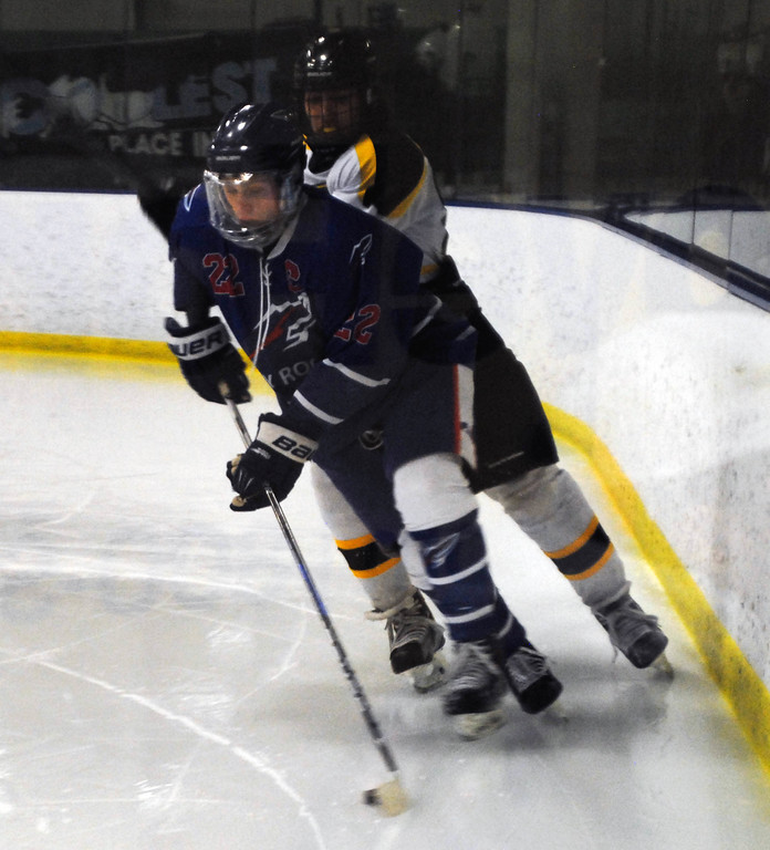 . Jon Behm - The Morning Journal<br> Bay senior Jake Gaudino brings the puck behind the net against Amherst during the first period of a Baron Cup II quarterfinal on Feb. 5 at Brooklyn\'s John M. Coyne Recreation Center.