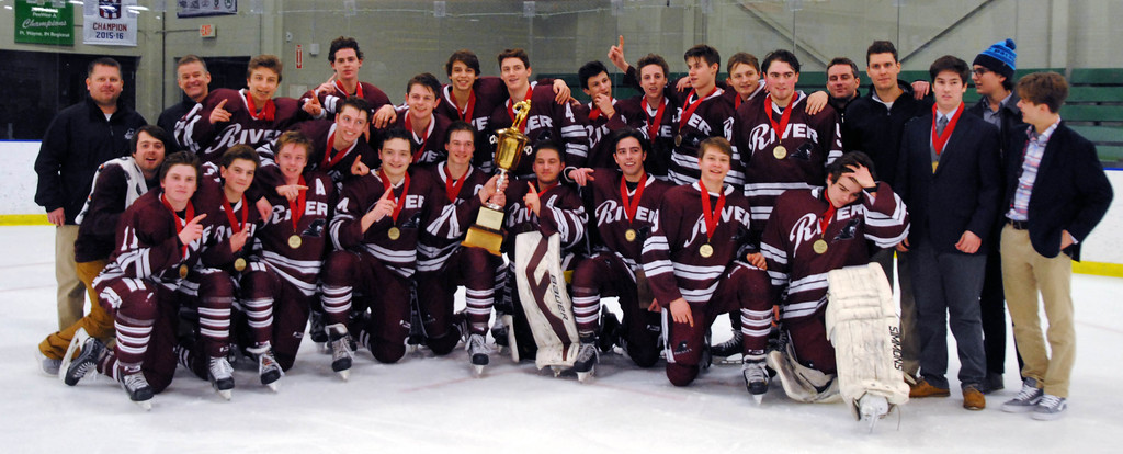 . Jon Behm - The Morning Journal<br> Rocky River poses with the Baron Cup I trophy following a 2-1 win over Shaker Heights on Feb. 11 at Brooklyn\'s John M. Coyne Recreation Center.