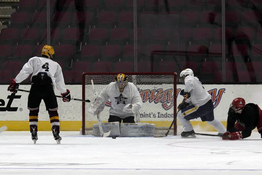 . Jen Forbus - The Morning Journal<br> Taking over goalie duties in the second half of the White v. Black first round, Avon\'s Danny Fielding keeps himself firmly in front Chris Heim\'s (Kent Roosevelt) shot.