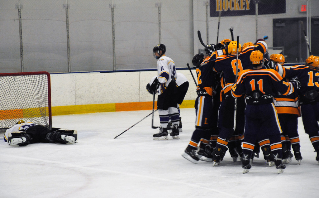 . Jon Behm - The Morning Journal<br> Lakewood\'s mobs Patrick Gilman as Avon goalie Danny Fielding lays on the ice in defeat after the Rangers\' senior scored a game-winning goal in overtime during a Southwestern Conference Tournament first round game on Jan. 13.