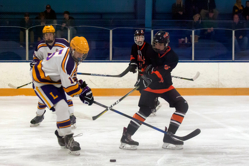 . Jen Forbus - The Morning Journal<br> Lakewood\'s Jonas Hupcey and North Olmsted\'s Justin Christ vie for possession of the puck on Jan. 14.
