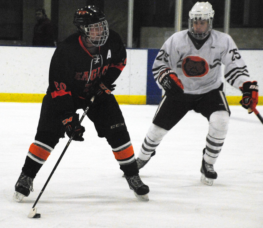 . Jon Behm - The Morning Journal<br> North Olmsted junior Travis Vitaz looks to make a pass as Padua\'s CJ Talion defends during the first period of a Brooklyn District first round game on Feb. 13 at Brooklyn\'s John M. Coyne Recreation Center.