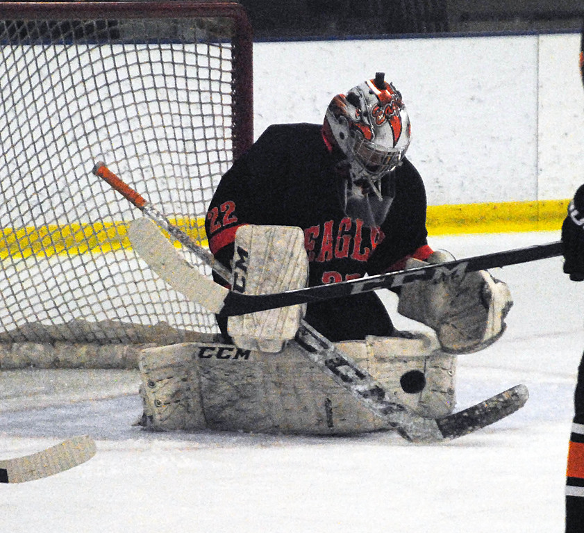 . Jon Behm - The Morning Journal<br> North Olmsted senior goalie Ryan Godin makes a save against Padua during the first period of a Brooklyn District first round game on Feb. 13 at Brooklyn\'s John M. Coyne Recreation Center.