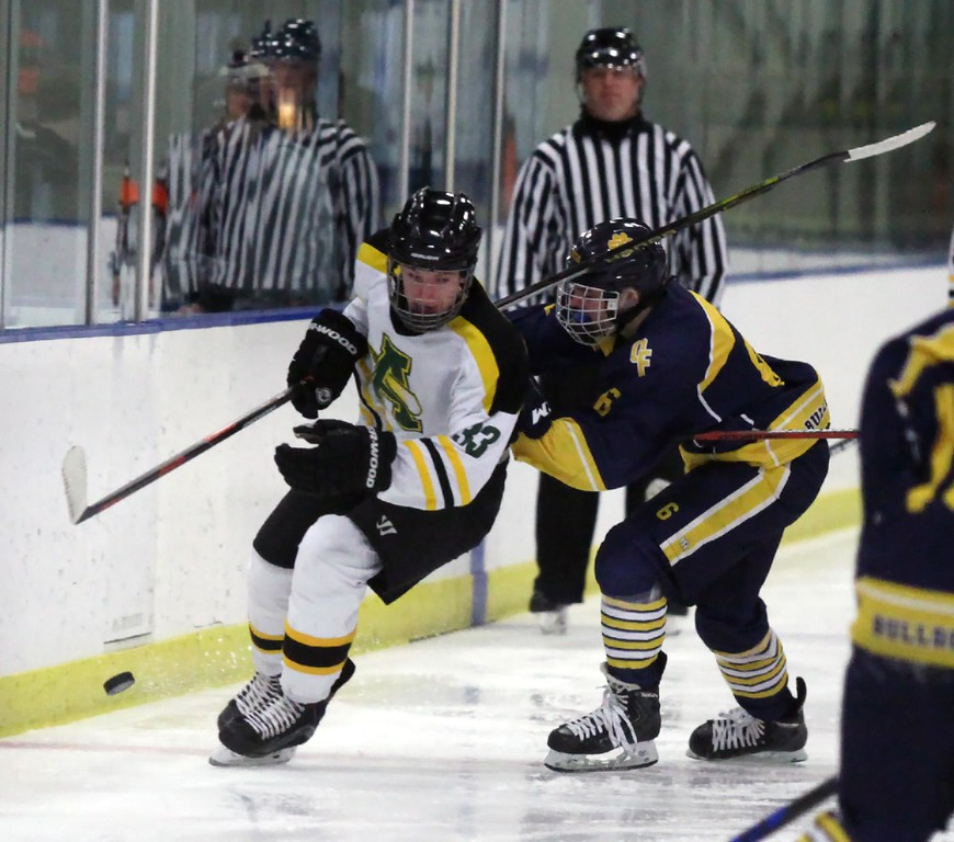 . Randy Meyers - The Morning Journal<br> Tyler Waldecki of Amherst is checked into the boards by Colin Wilson of Olmsted Falls during the first period of the Baron Cup II final on Feb. 11.