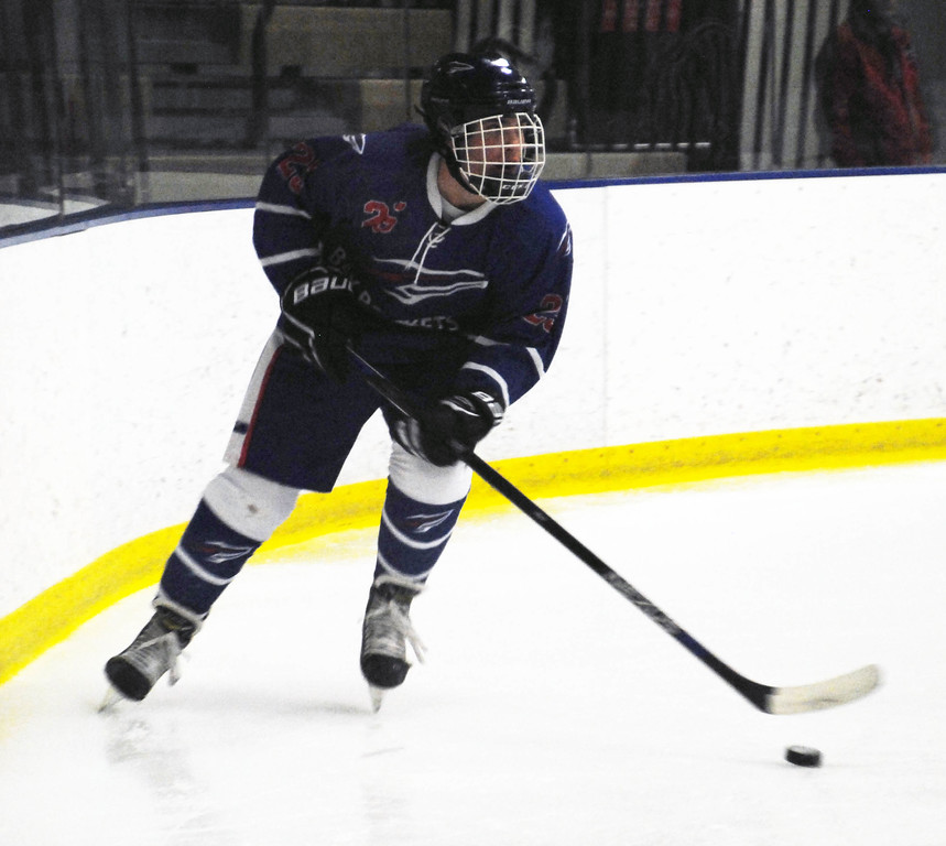 . Jon Behm - The Morning Journal<br> Bay\'s Chris Eifert brings the puck around net during the first period against Midview in a Brooklyn District first round game on Feb. 12 at Brooklyn\'s John M. Coyne Recreaton Center.