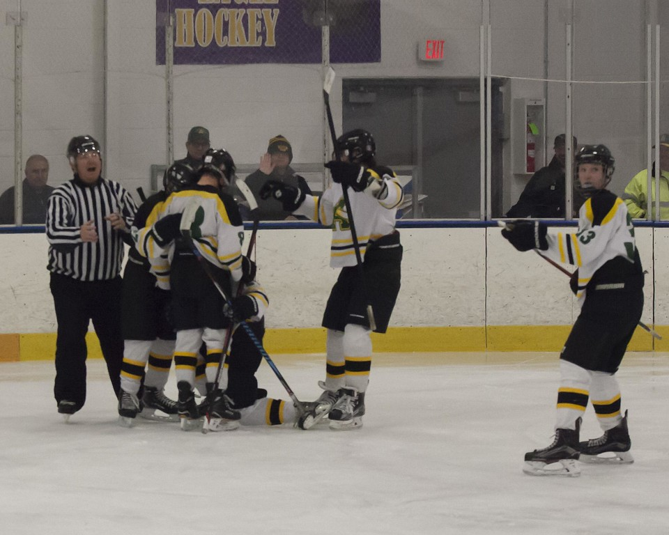 . Jen Forbus - The Morning Journal<br> Amherst celebrates Jacob Fekete\'s goal in the final seconds of the game.