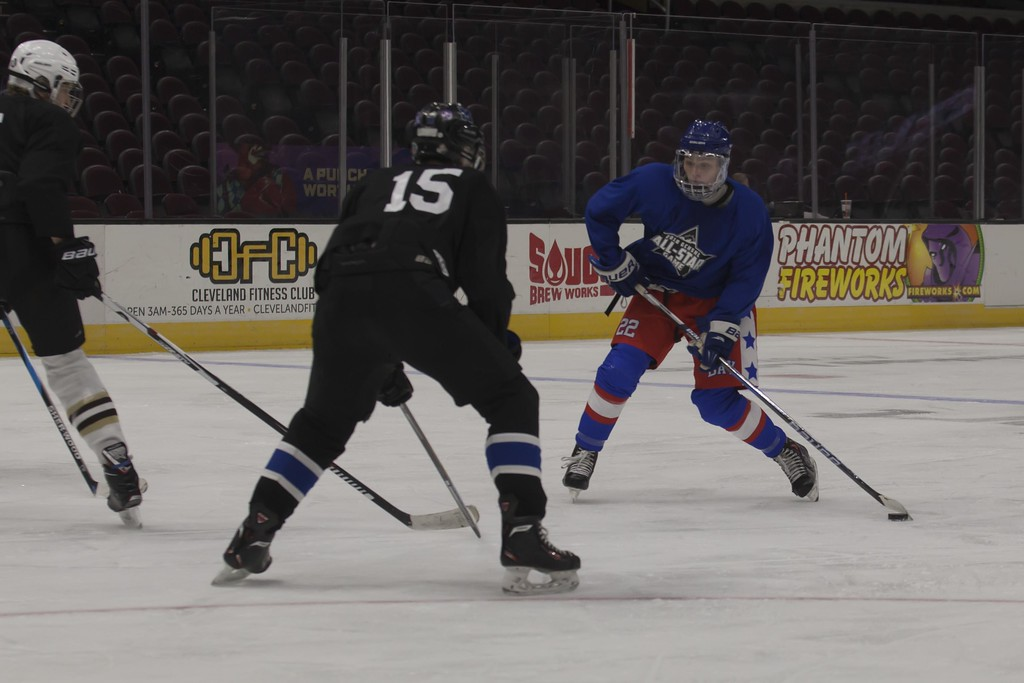 . Jen Forbus - The Morning Journal<br> Bay\'s Jake Gaudino squares off against Midview\'s Heath Naso in the consolation third round, Blue Team vs. Black Team, of the GCHSHL All-Star Hockey game at the Quicken Loans Area on Sunday.
