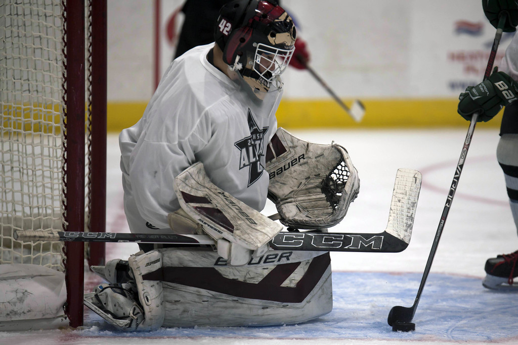 . Jen Forbus - The Morning Journal<br> Rocky River goalie Ryan Dunning protects the goal for the White team in the GCHSHL All-Star Hockey game at the Quicken Loans Area on Sunday.
