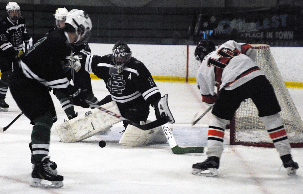 . Jon Behm - The Morning Journal<br> Elyria Catholic goalie Kevin Hahn makes a save on Normandy\'s Alex Franke during the first period of a Brooklyn District sectional semifinal on Feb. 18 at Brooklyn\'s John M. Coyne Recreation Center.