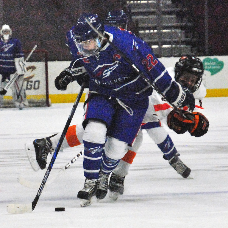 . Jon Behm - The Morning Journal<br> Bay\'s Jake Gaudino fends off North Olmsted\'s Cameron Sukenik during the first period on Dec. 22 at The Q.